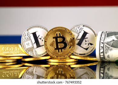 Physical version of Bitcoin, Litecoin, gold, US Dollar and Netherlands Flag. Conceptual image for investors in cryptocurrency, gold and dollars.