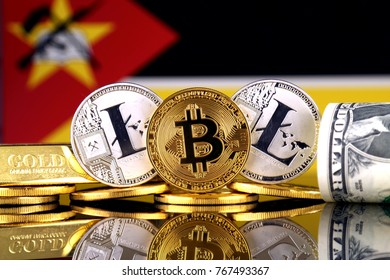 Physical version of Bitcoin, Litecoin, gold, US Dollar and Mozambique Flag. Conceptual image for investors in cryptocurrency, gold and dollars.
