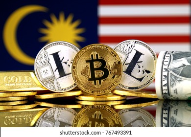 Physical version of Bitcoin, Litecoin, gold, US Dollar and Malaysia Flag. Conceptual image for investors in cryptocurrency, gold and dollars.