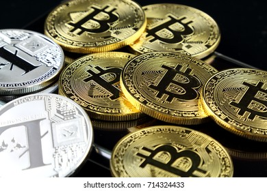 Physical version of Bitcoin and Litecoin, new virtual money. Conceptual image for worldwide cryptocurrency and digital payment system called the first decentralized digital currency.