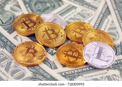 Physical version of Bitcoin and Litecoin (new virtual money) and banknotes of one dollar. Exchange bitcoin for a dollar. Conceptual image for worldwide cryptocurrency and digital payment system.