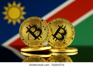 Physical version of Bitcoin and Namibia Flag. Close up.