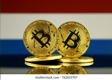 Physical version of Bitcoin and Netherlands Flag. Close up.