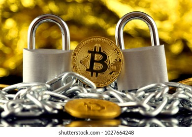 Physical version of Bitcoin (new virtual money), two silver padlocks and chain. Prohibition of cryptocurrencies, regulations, restrictions or security, protection, privacy.
