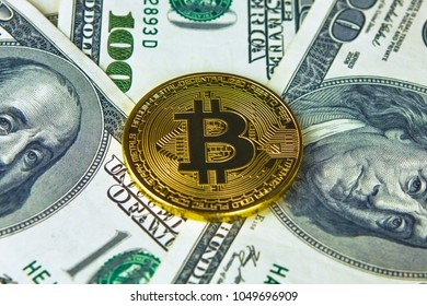 Physical version of Bitcoin new virtual money and banknotes of dollars. Exchange bitcoin for a dollar. Conceptual image for worldwide cryptocurrency and digital payment system.