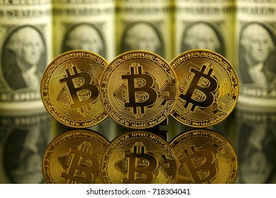 Physical version of Bitcoin (new virtual money) and banknotes of one dollar. Exchange bitcoin for a dollar. Conceptual image for worldwide cryptocurrency and digital payment system.
