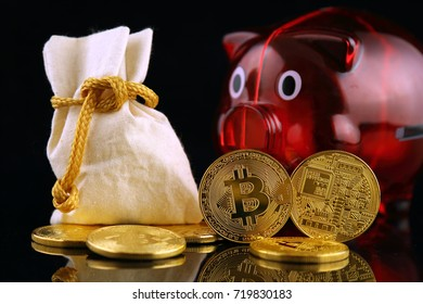 Physical version of Bitcoin (new virtual money) and Piggy Bank. Conceptual image for worldwide cryptocurrency and digital payment system called the first decentralized digital currency.