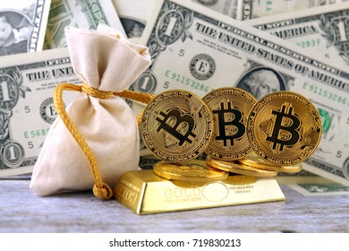 Physical version of Bitcoin, new virtual money. Conceptual image for investors in cryptocurrency, gold and dollars.