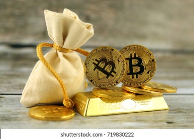 Physical version of Bitcoin, new virtual money. Conceptual image for investors in cryptocurrency and gold.