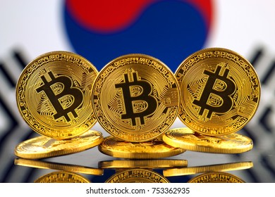 Physical version of Bitcoin (new virtual money) and South Korea Flag.