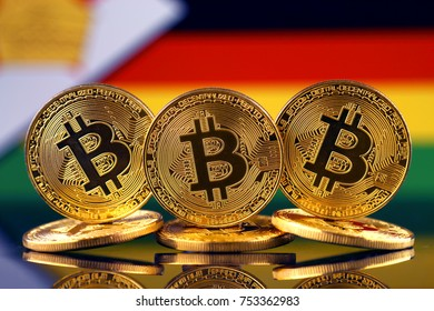 Physical version of Bitcoin (new virtual money) and Zimbabwe Flag.
