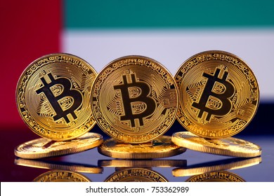 Physical version of Bitcoin (new virtual money) and United Arab Emirates Flag.