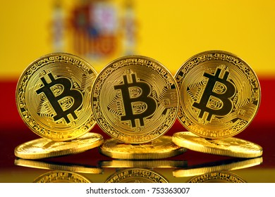 Physical version of Bitcoin (new virtual money) and Spain Flag.