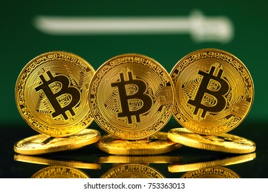 Physical version of Bitcoin (new virtual money) and Saudi Arabia Flag.