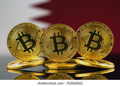 Physical version of Bitcoin (new virtual money) and Qatar Flag.