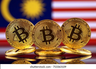 Physical version of Bitcoin (new virtual money) and Malaysia Flag.