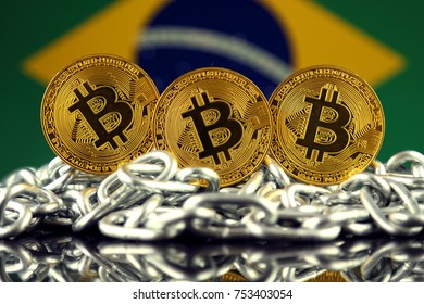 Physical version of Bitcoin (new virtual money), chain and Brazil Flag.