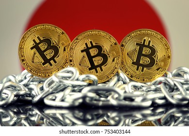 Physical version of Bitcoin (new virtual money), chain and Japan Flag.