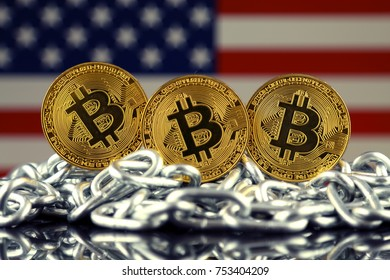 Physical version of Bitcoin (new virtual money), chain and USA Flag.