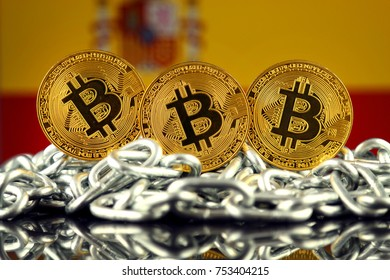 Physical version of Bitcoin (new virtual money), chain and Spain Flag.