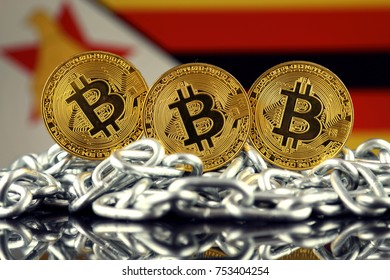 Physical version of Bitcoin (new virtual money), chain and Zimbabwe Flag.