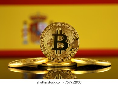 Physical version of Bitcoin (new virtual money) and Spain Flag. Conceptual image for investors in cryptocurrency and Blockchain Technology in Spain.