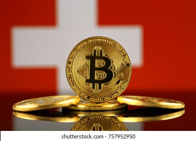 Physical version of Bitcoin (new virtual money) and Switzerland Flag. Conceptual image for investors in cryptocurrency and Blockchain Technology in Switzerland.