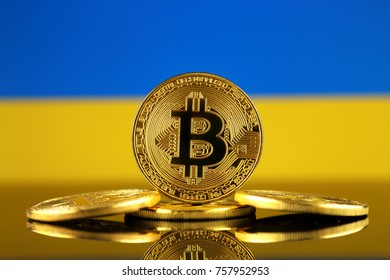 Physical version of Bitcoin (new virtual money) and Ukraine Flag. Conceptual image for investors in cryptocurrency and Blockchain Technology in Ukraine.