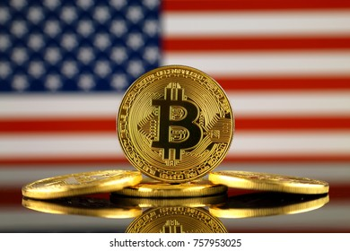 Physical version of Bitcoin (new virtual money) and USA Flag. Conceptual image for investors in cryptocurrency and Blockchain Technology in United States.