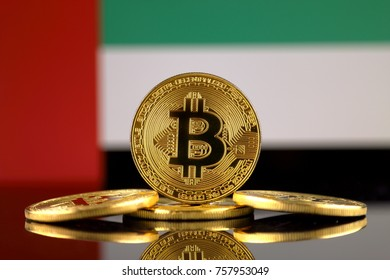Physical version of Bitcoin (new virtual money) and United Arab Emirates Flag. Conceptual image for investors in cryptocurrency and Blockchain Technology in United Arab Emirates.