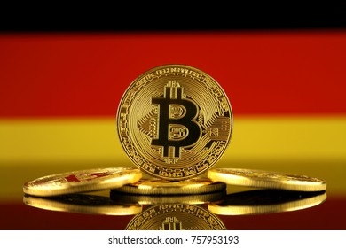 Physical version of Bitcoin (new virtual money) and Germany Flag. Conceptual image for investors in cryptocurrency and Blockchain Technology in Germany.