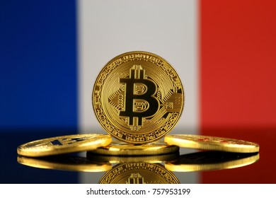 Physical version of Bitcoin (new virtual money) and France Flag. Conceptual image for investors in cryptocurrency and Blockchain Technology in France.