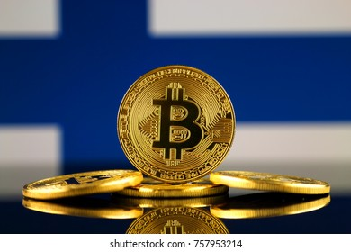 Physical version of Bitcoin (new virtual money) and Finland Flag. Conceptual image for investors in cryptocurrency and Blockchain Technology in Finland.
