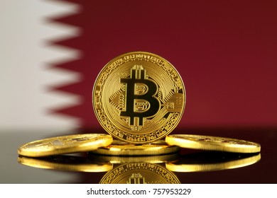 Physical version of Bitcoin (new virtual money) and Qatar Flag. Conceptual image for investors in cryptocurrency and Blockchain Technology in Qatar.