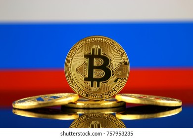 Physical version of Bitcoin (new virtual money) and Russia Flag. Conceptual image for investors in cryptocurrency and Blockchain Technology in Russia.
