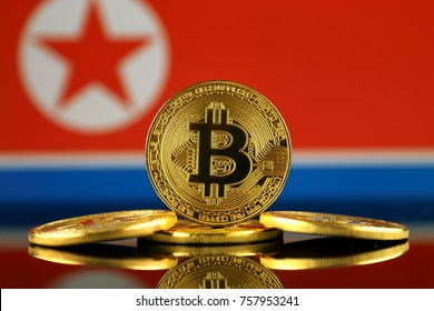 Physical version of Bitcoin (new virtual money) and North Korea Flag. Conceptual image for investors in cryptocurrency and Blockchain Technology in North Korea.