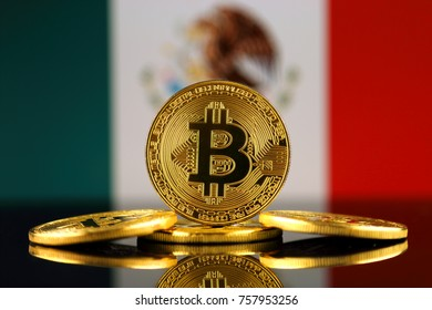Physical version of Bitcoin (new virtual money) and Mexico Flag. Conceptual image for investors in cryptocurrency and Blockchain Technology in Mexico.
