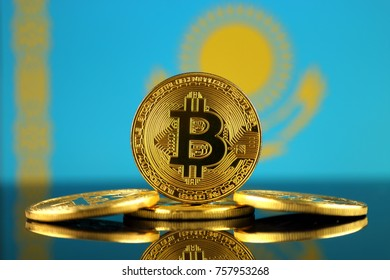 Physical version of Bitcoin (new virtual money) and Kazakhstan Flag. Conceptual image for investors in cryptocurrency and Blockchain Technology in Kazakhstan.