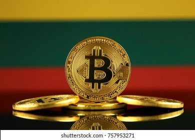 Physical version of Bitcoin (new virtual money) and Lithuania Flag. Conceptual image for investors in cryptocurrency and Blockchain Technology in Lithuania.