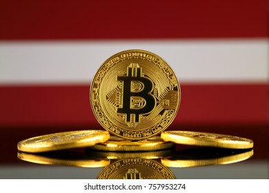 Physical version of Bitcoin (new virtual money) and Latvia Flag. Conceptual image for investors in cryptocurrency and Blockchain Technology in Latvia.
