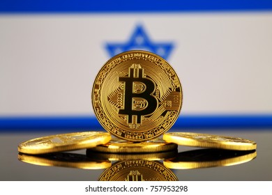 Physical version of Bitcoin (new virtual money) and Israel Flag. Conceptual image for investors in cryptocurrency and Blockchain Technology in Israel.