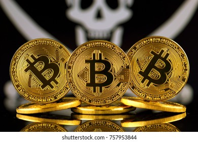 Physical version of Bitcoin (new virtual money) and Pirate Flag. Conceptual image for investors in cryptocurrency and Blockchain Technology. Risk, safety and security.