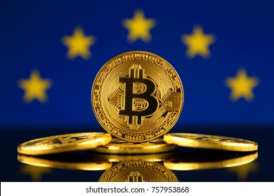 Physical version of Bitcoin (new virtual money) and EU Flag. Conceptual image for investors in cryptocurrency and Blockchain Technology in European Union.