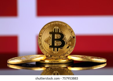 Physical version of Bitcoin (new virtual money) and Denmark Flag. Conceptual image for investors in cryptocurrency and Blockchain Technology in Denmark.