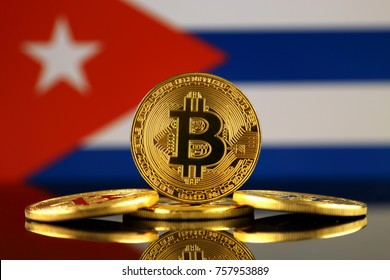 Physical version of Bitcoin (new virtual money) and Cuba Flag. Conceptual image for investors in cryptocurrency and Blockchain Technology in Cuba.