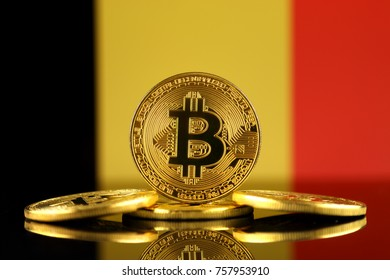 Physical version of Bitcoin (new virtual money) and Belgium Flag. Conceptual image for investors in cryptocurrency and Blockchain Technology in Belgium.