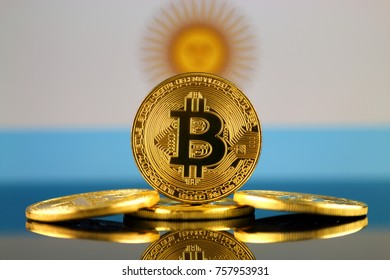Physical version of Bitcoin (new virtual money) and Argentina Flag. Conceptual image for investors in cryptocurrency and Blockchain Technology in Argentina.