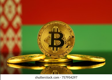 Physical version of Bitcoin (new virtual money) and Belarus Flag. Conceptual image for investors in cryptocurrency and Blockchain Technology in Belarus.