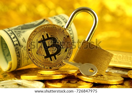 Physical version of Bitcoin (new virtual money), golden padlock and banknotes of one dollar. Conceptual image for money and cryptocurrency security.