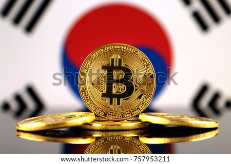 Physical version of Bitcoin (new virtual money) and South Korea Flag. Conceptual image for investors in cryptocurrency and Blockchain Technology in South Korea.
